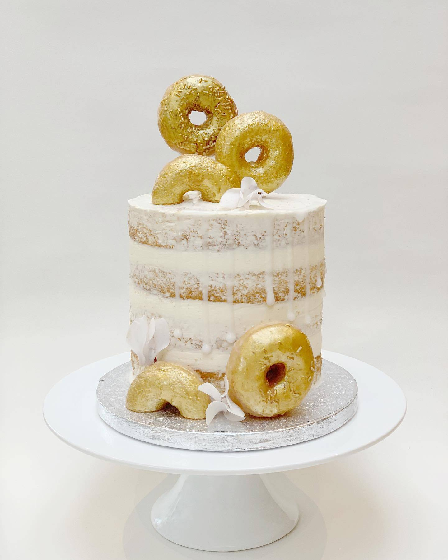 Semi Naked Cake with Gold Donuts